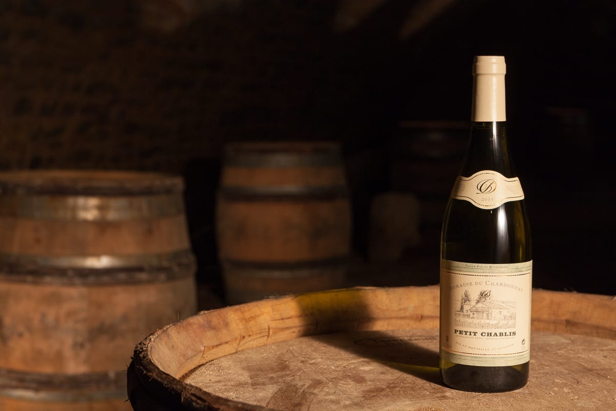 Bottle of Chablis 2015 on a barrel