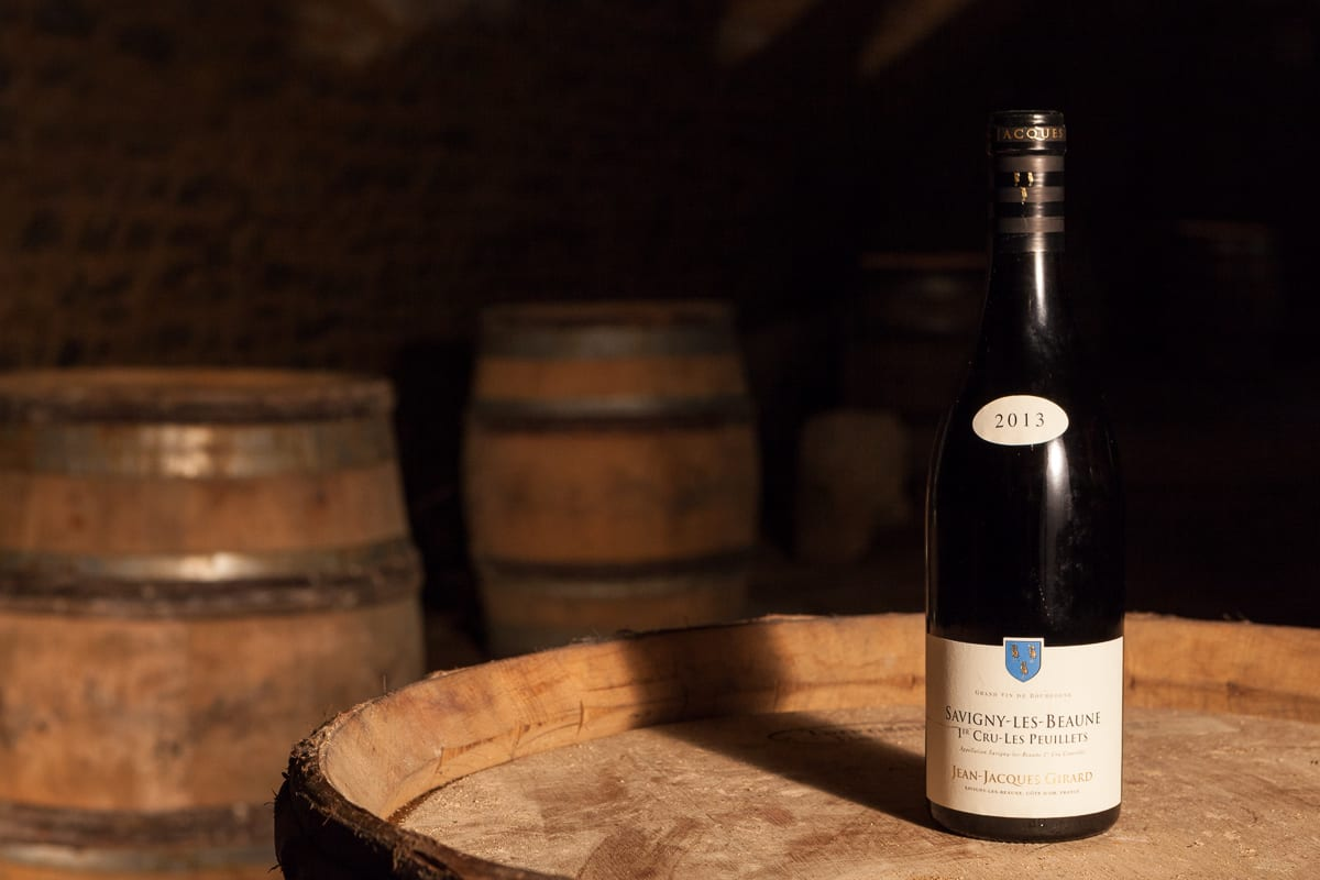 2013 burgundy wine bottle in a cellar